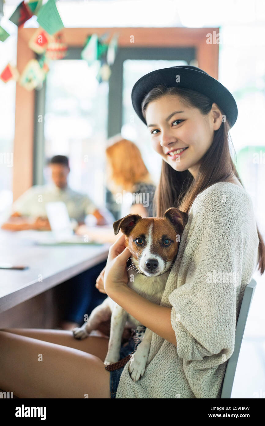 People holding dog at conference table in office - Stock Image