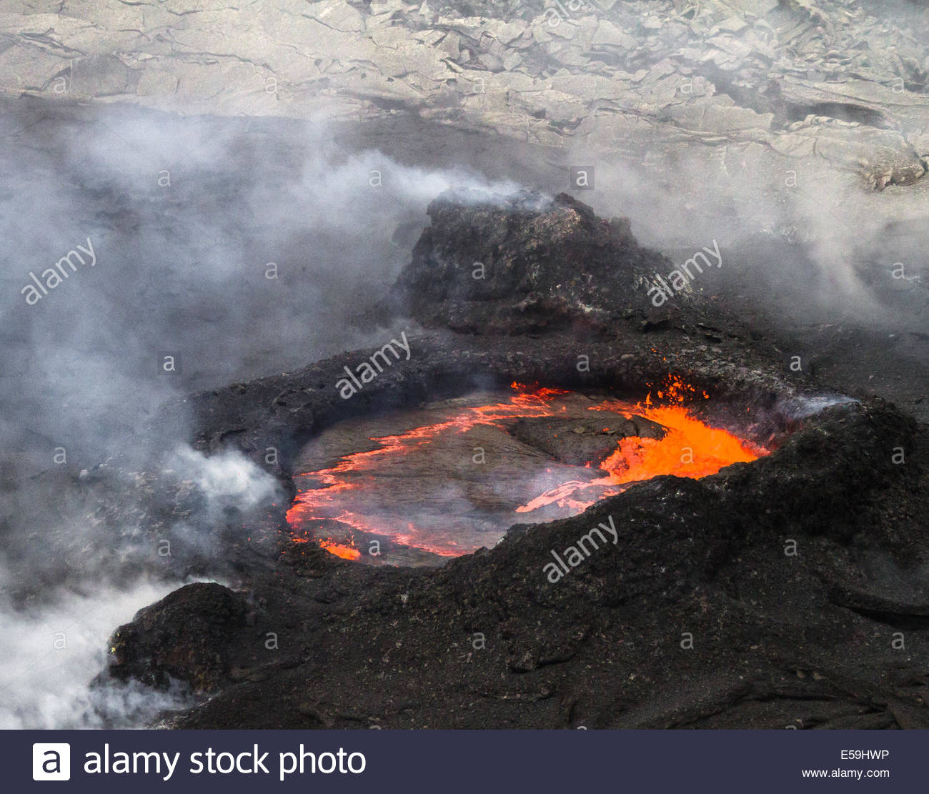 Lava erupting from spatter cones within Pu'u O'o Vent - USA - Hawaii - Stock Image
