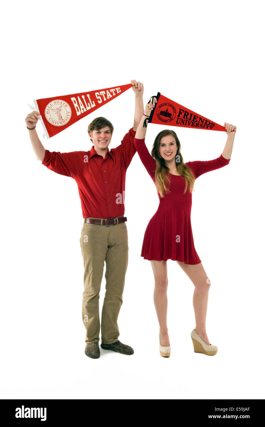 Brother and Sisiter Displaying their University Pennants - Stock Image
