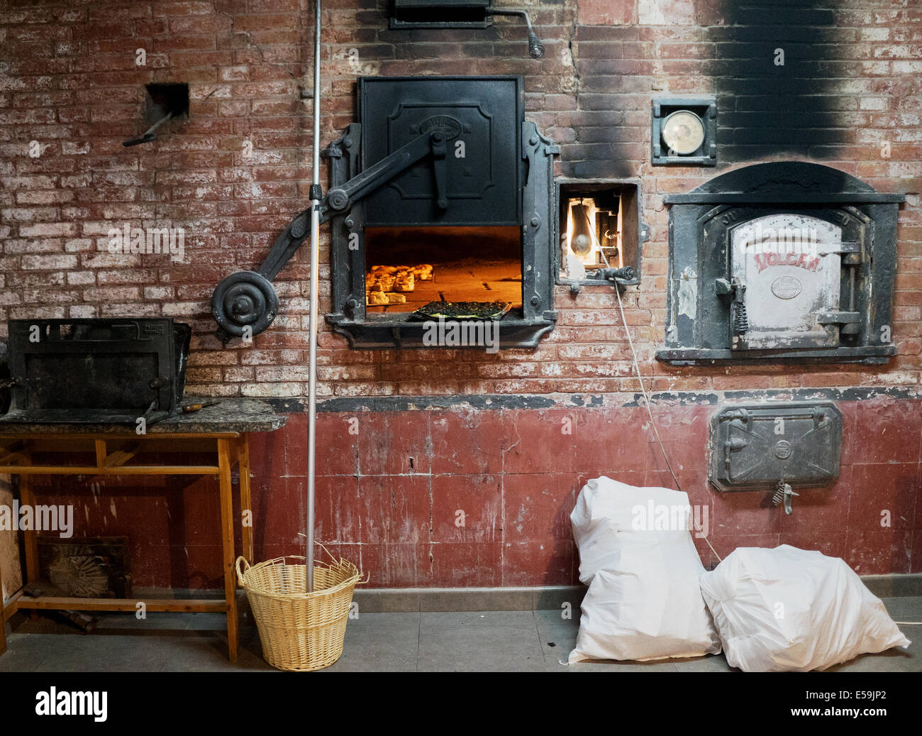 Interior View Of An Old Traditional Spanish Bakery Bread Shop With Wood Oven Baking Loaves And Pastries Pies