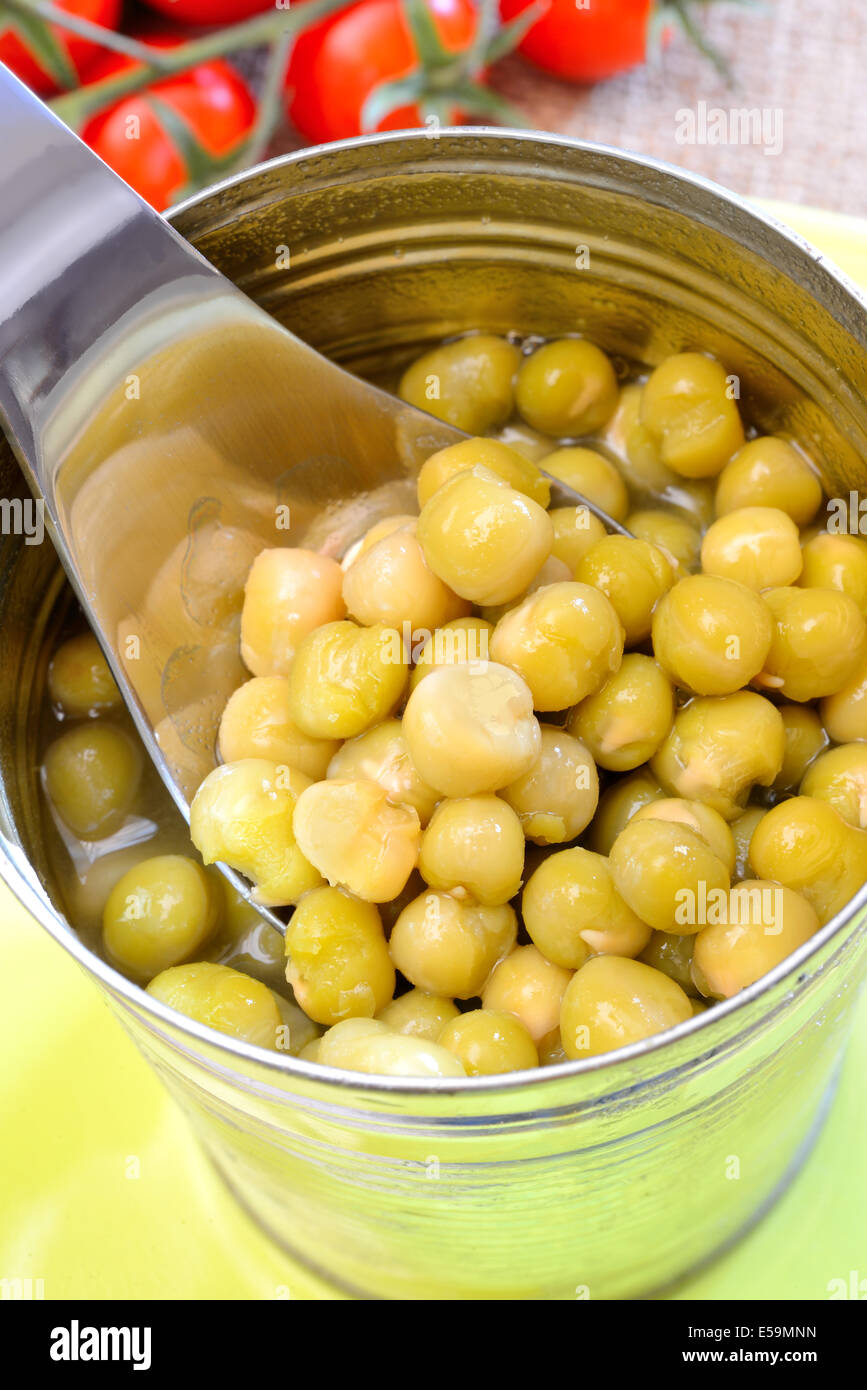 jar of preserved green peas cooked - Stock Image