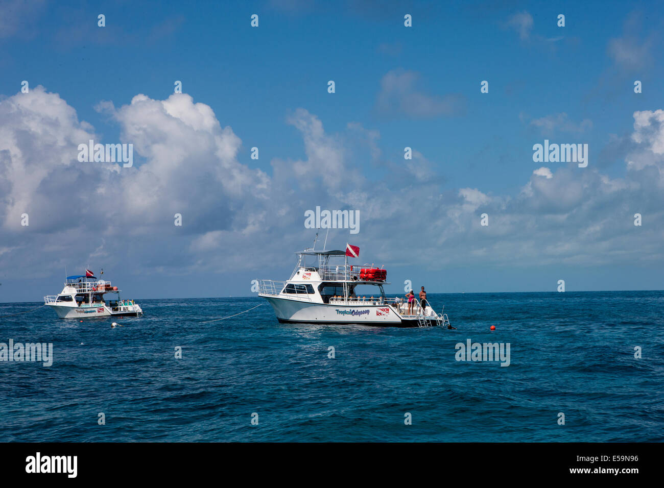 Dive boats on the reef. - Stock Image