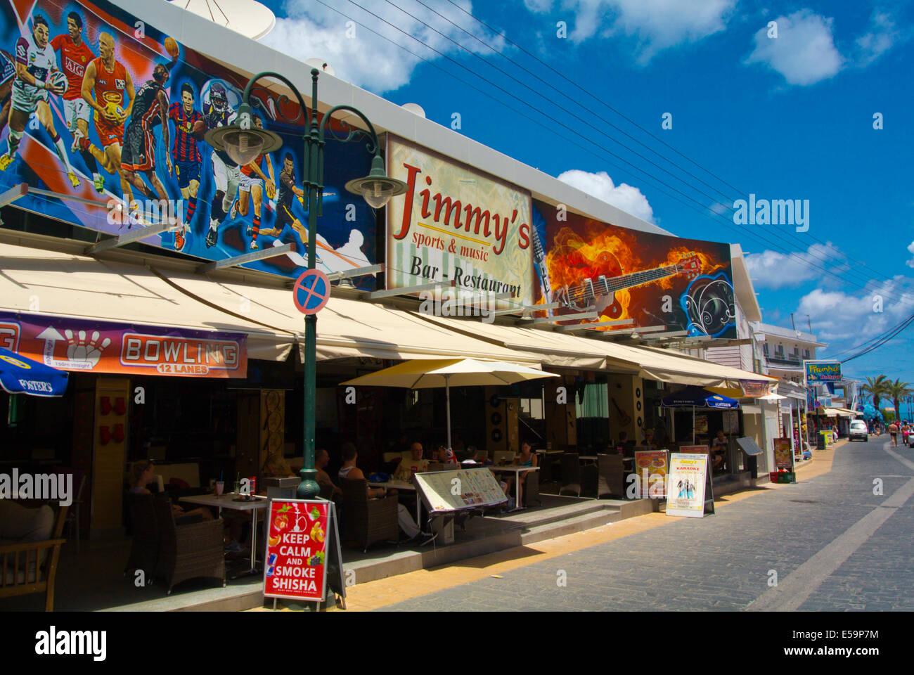 Main street with bars and cafes, Faliraki resort, Rhodes island, Dodecanese islands, Greece, Europe - Stock Image