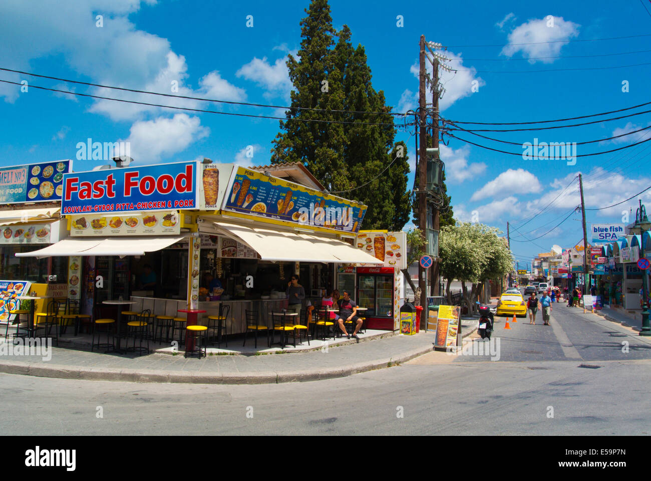 Main street with fast food restaurants, Faliraki resort, Rhodes island, Dodecanese islands, Greece, Europe Stock Photo