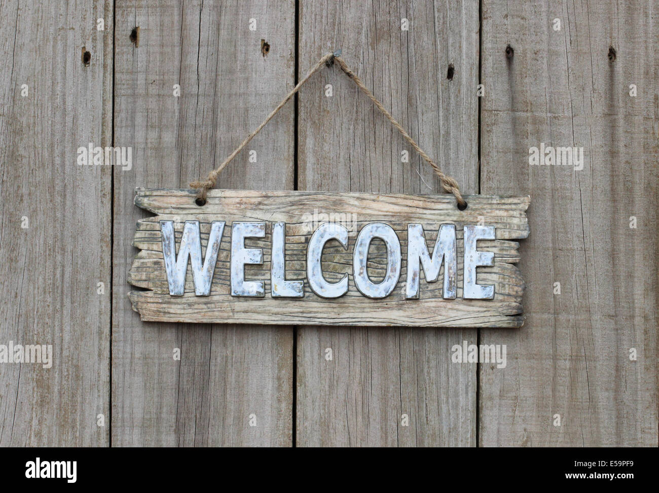 Rustic Wood Welcome Sign Hanging On Wooden Background