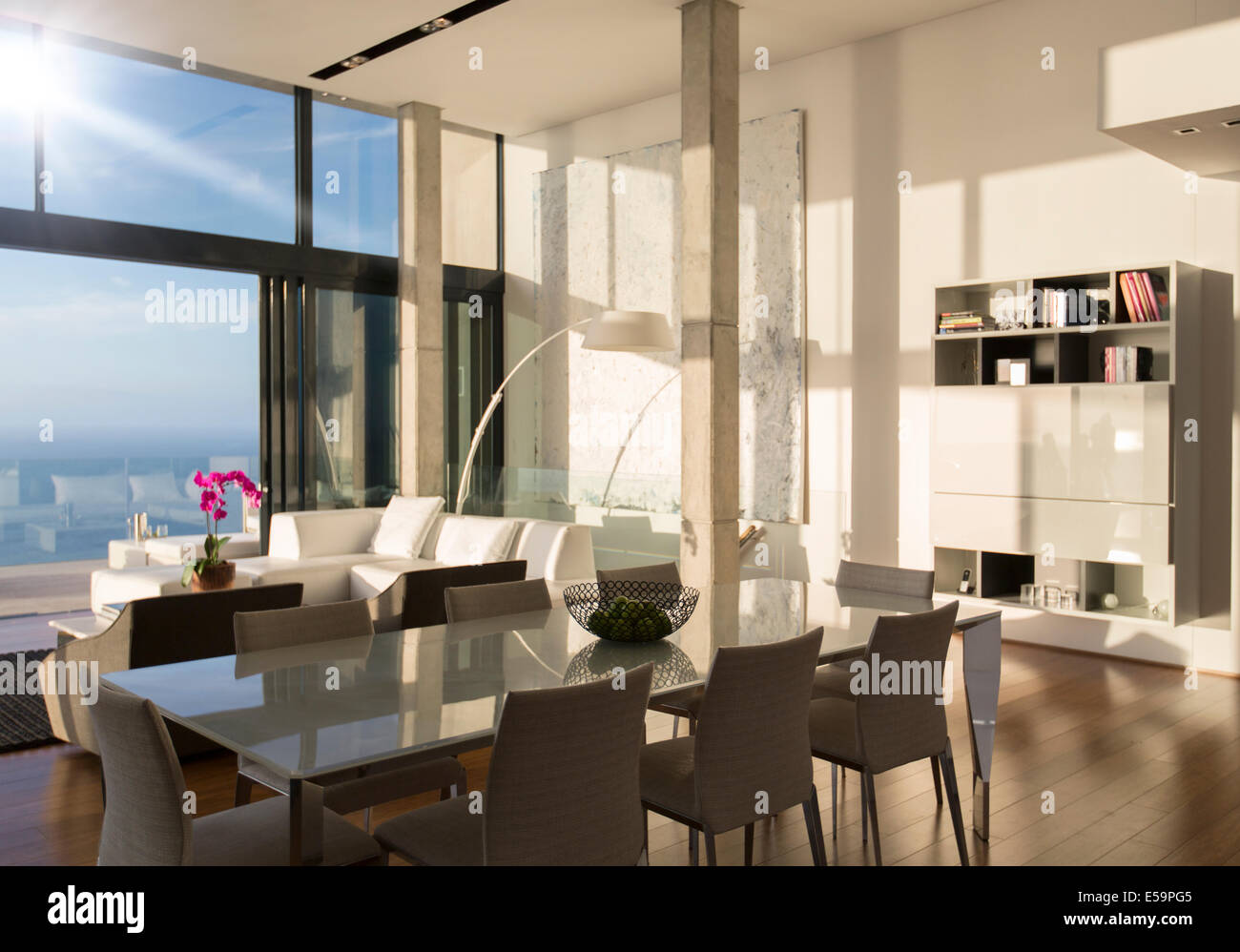 Dining and living space in modern house - Stock Image