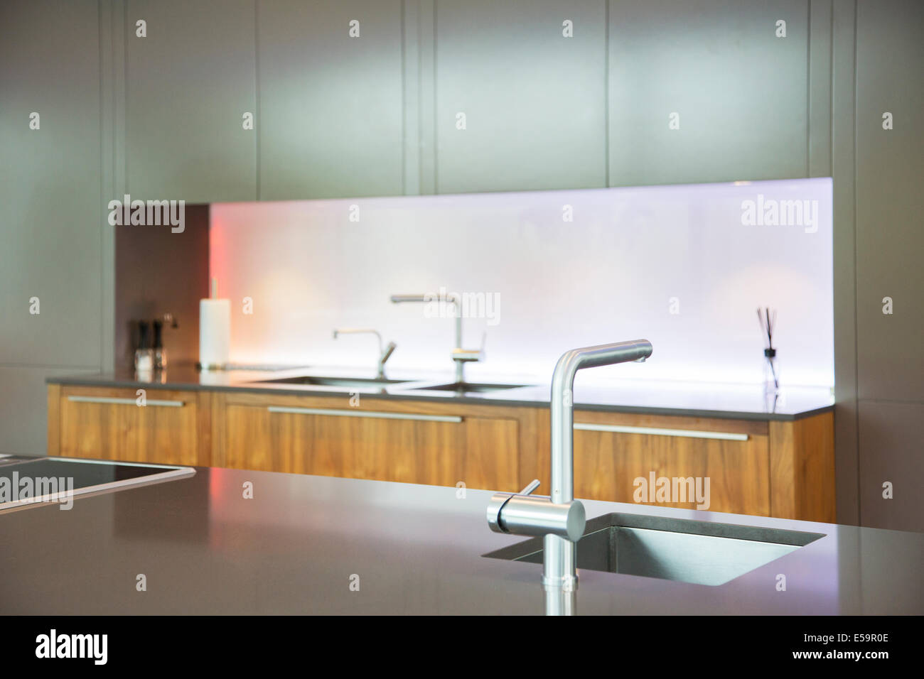 Sinks and faucets in modern kitchen - Stock Image