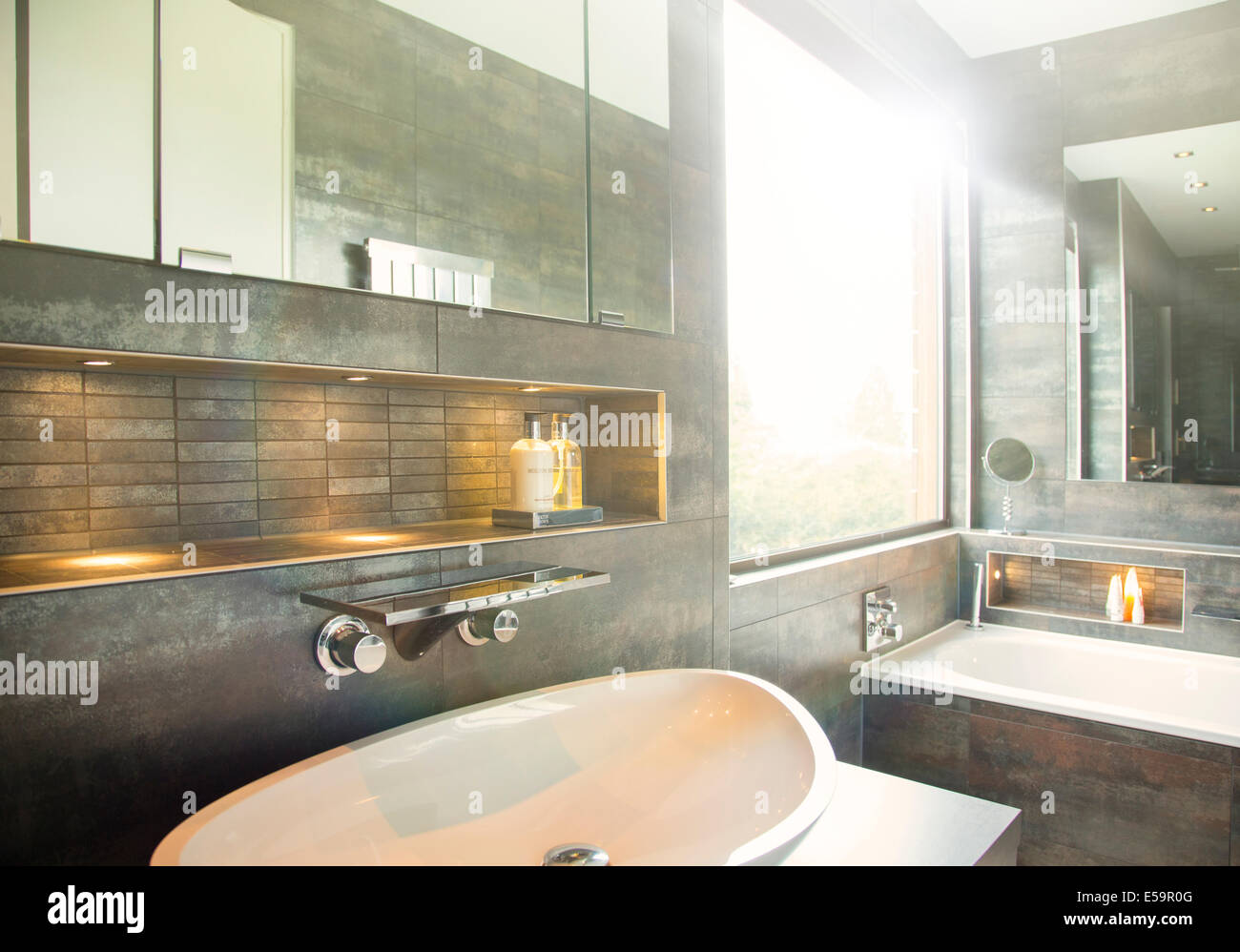 Mirror and sink in modern bathroom - Stock Image