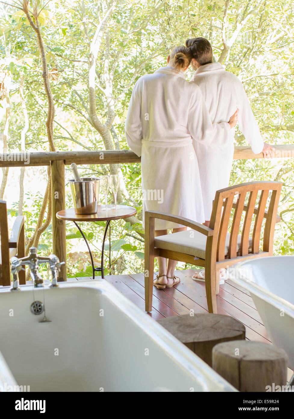 Couple relaxing together in spa - Stock Image