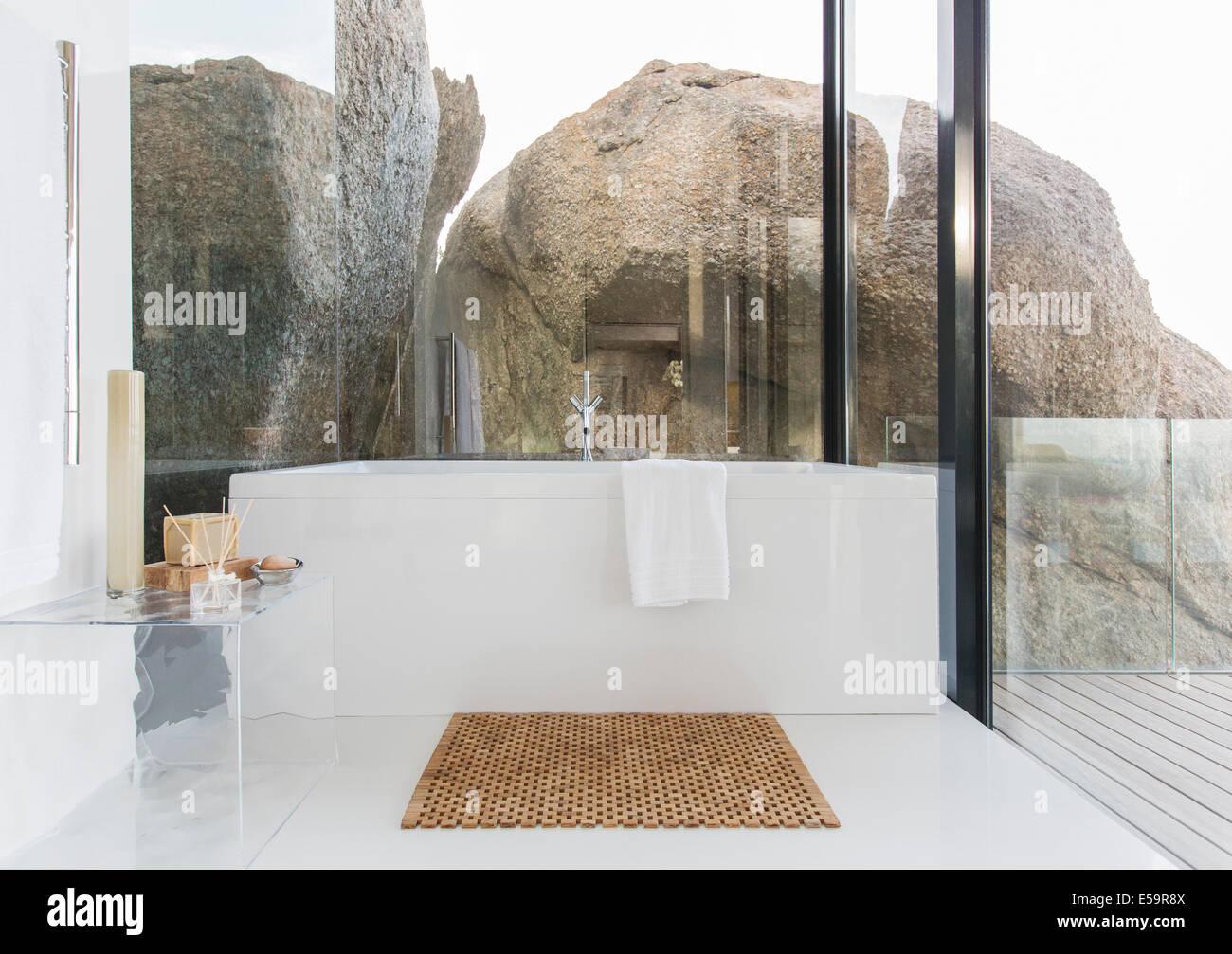 Bathtub and glass walls in modern bathroom - Stock Image