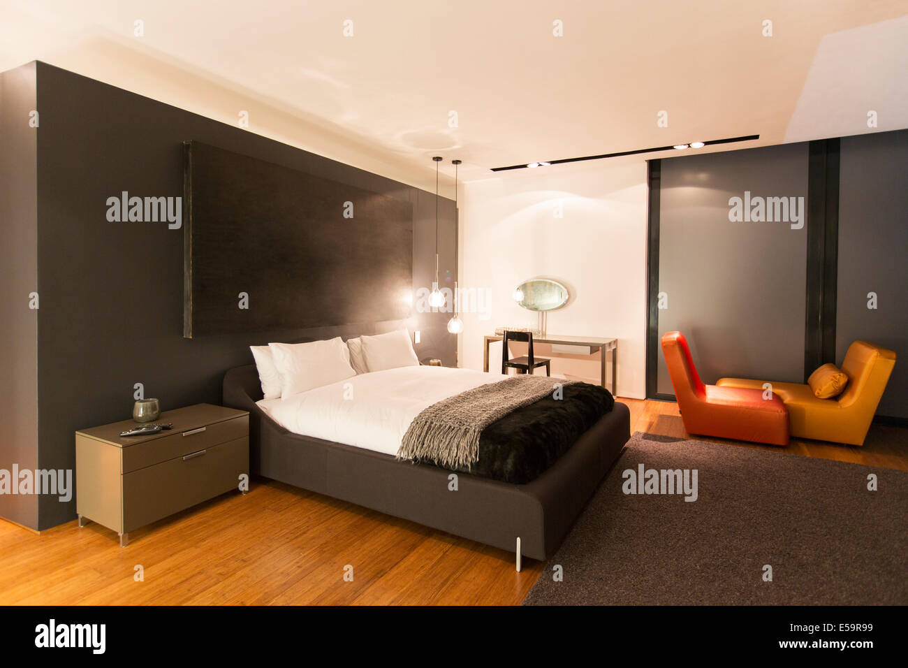 Rug and painting in modern bedroom Stock Photo: 72130613 - Alamy