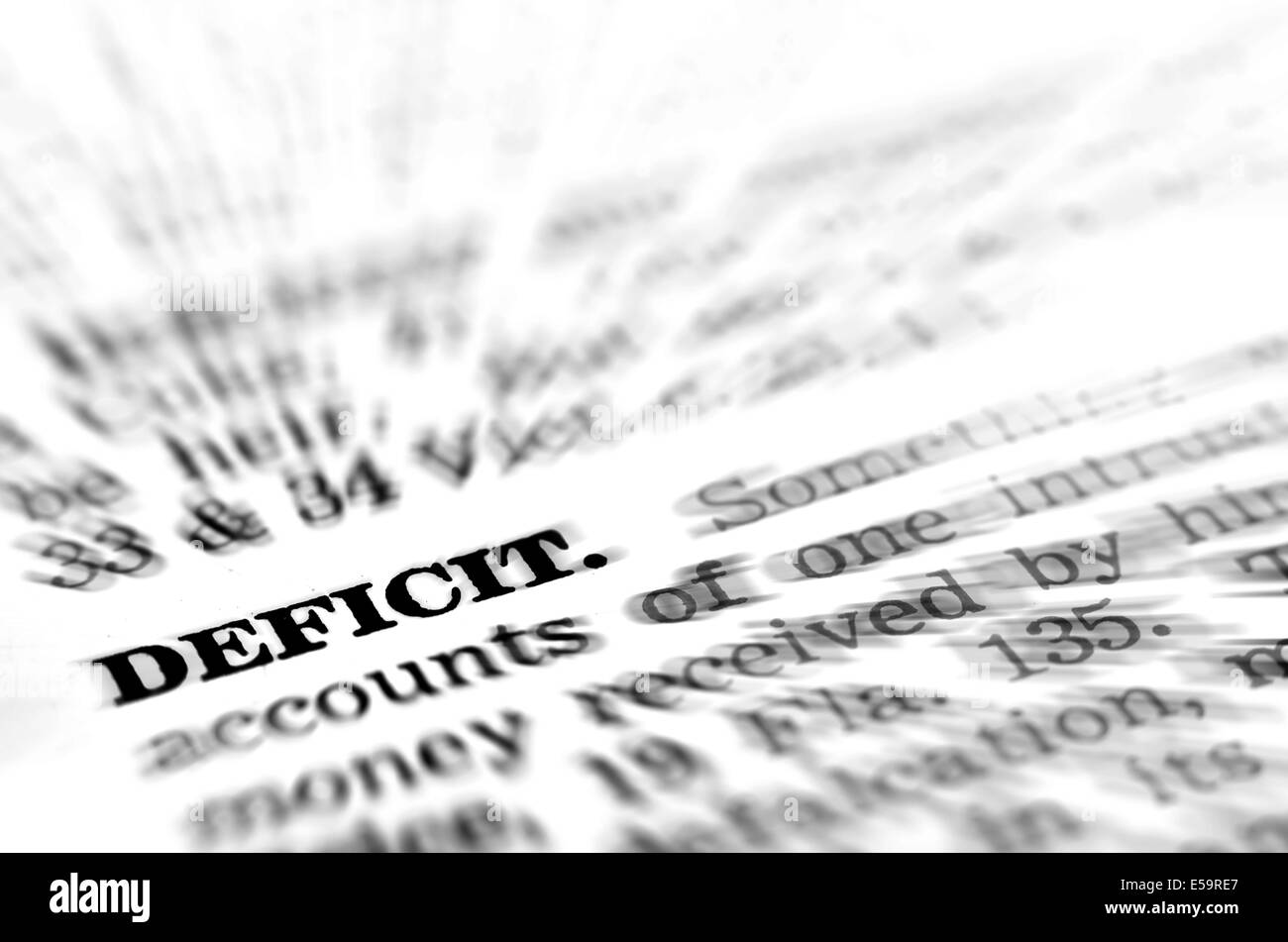 Detailed closeup of definition of the word Deficit - Stock Image