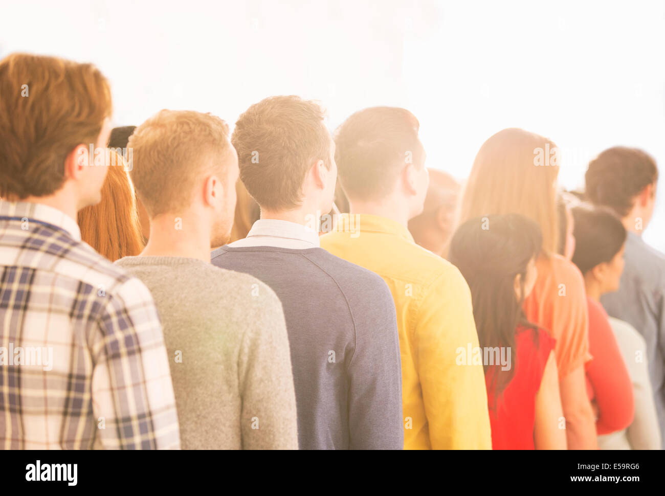 Crowd waiting in queue - Stock Image