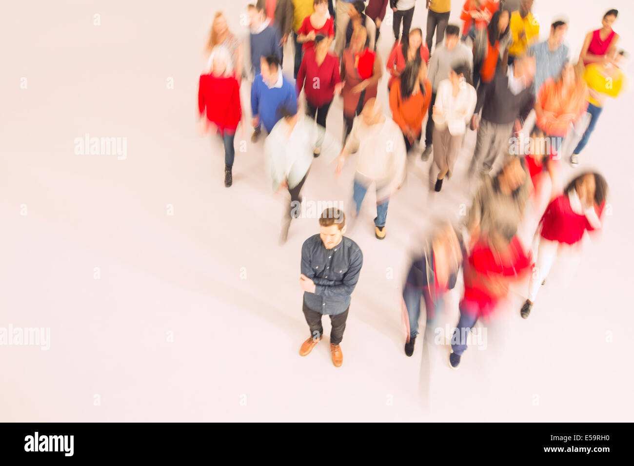 Businessman standing out from the crowd - Stock Image