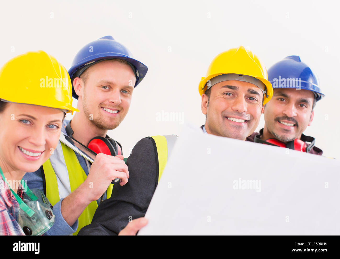 Portrait of confident construction workers - Stock Image