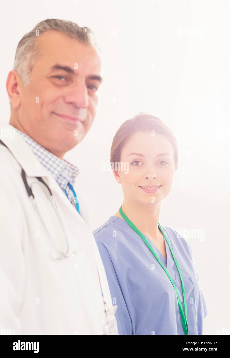 Portrait of confident doctor and nurse - Stock Image