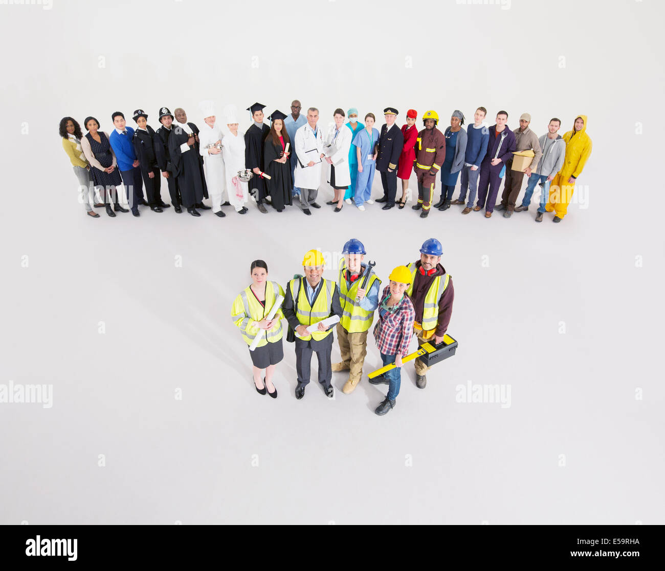 Workforce behind construction workers - Stock Image