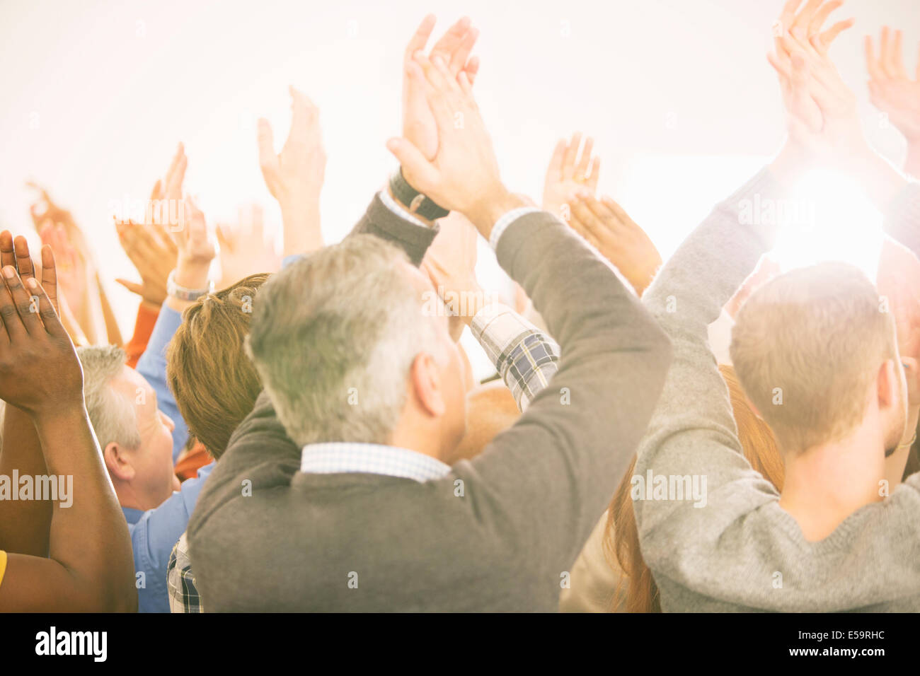 Crowd clapping - Stock Image