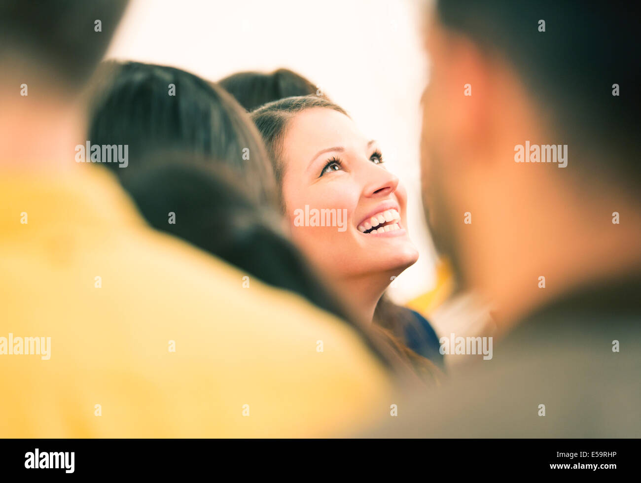 Enthusiastic woman looking up - Stock Image