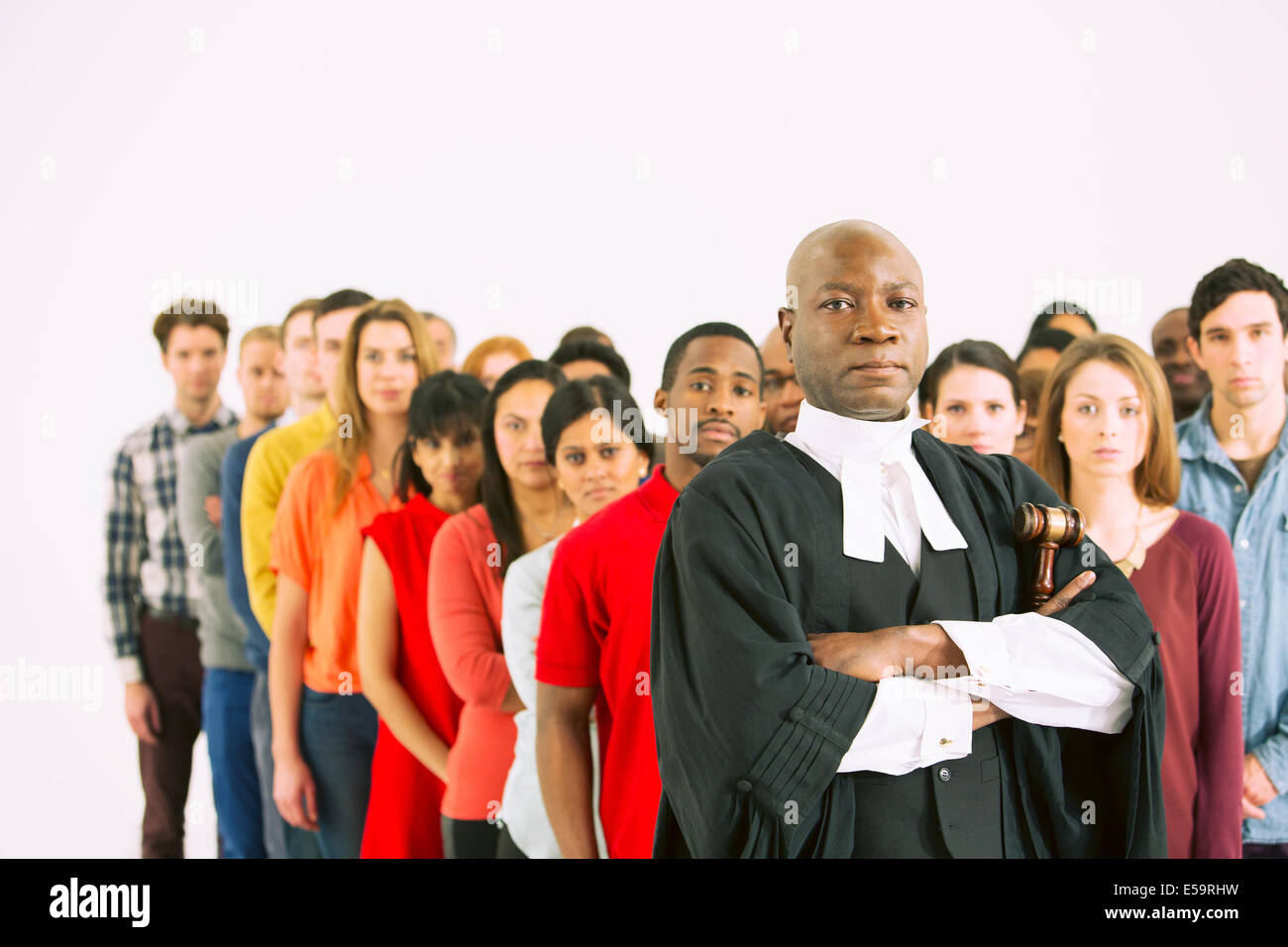 Serious judge in front of crowd - Stock Image
