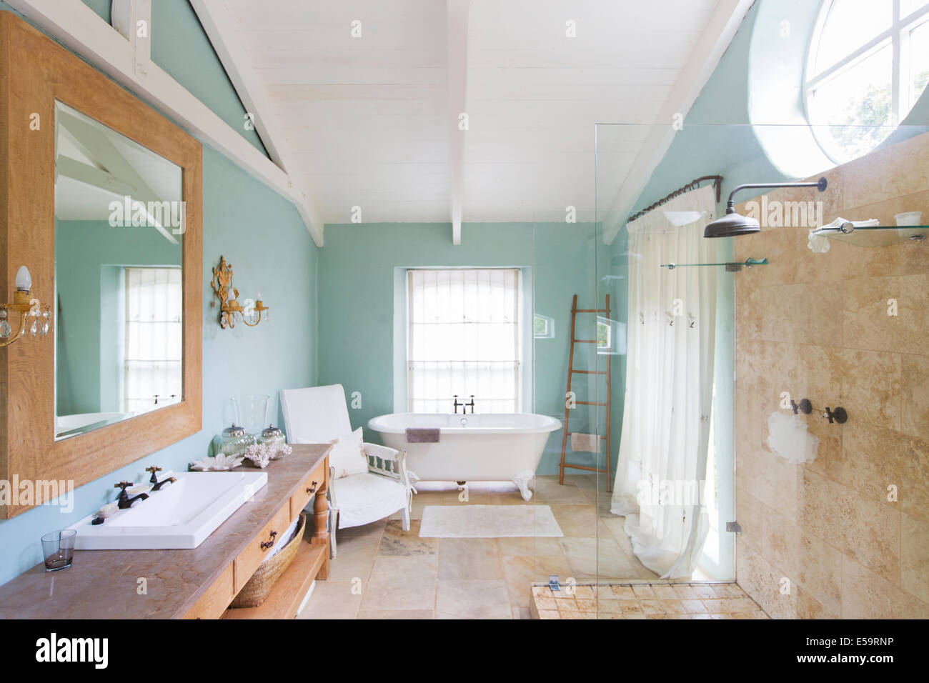 Bathtub and shower in rustic bathroom - Stock Image