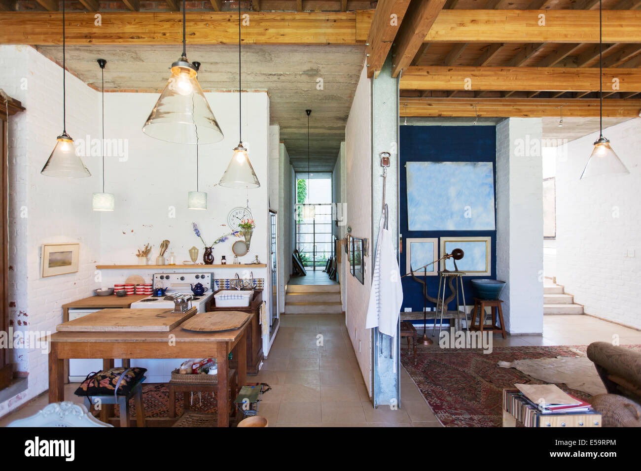 Kitchen and living area of rustic house - Stock Image