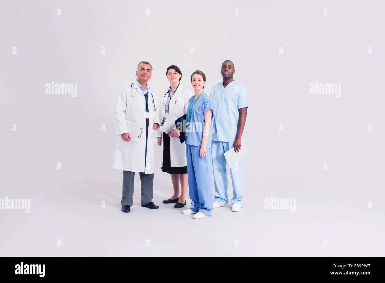 Portrait of confident doctors and nurses - Stock Image