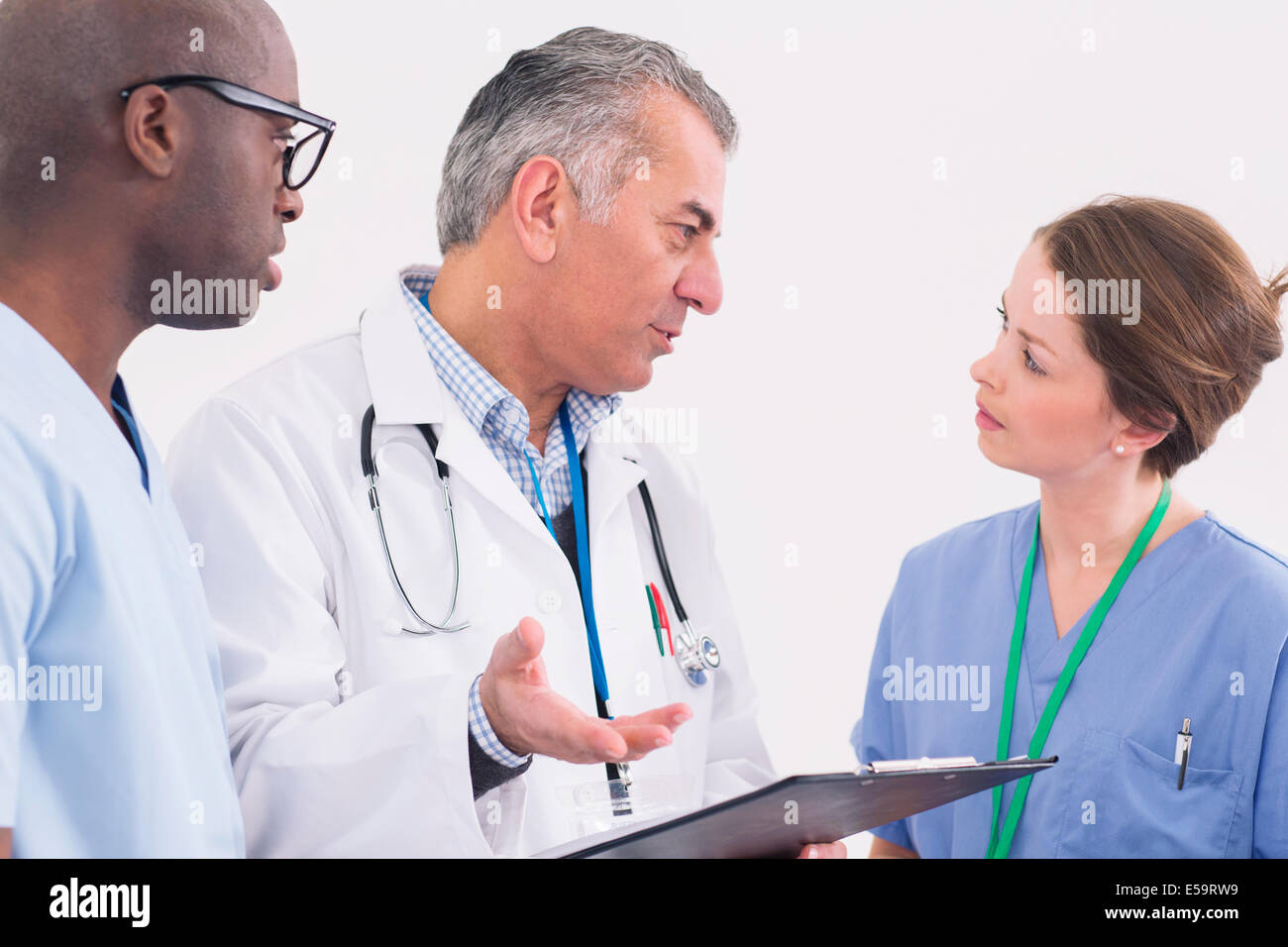 Doctor and nurses talking - Stock Image