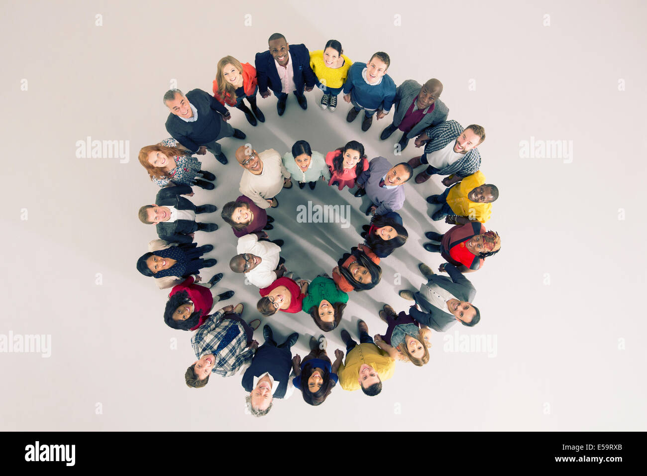 Portrait of diverse crowd in huddle - Stock Image
