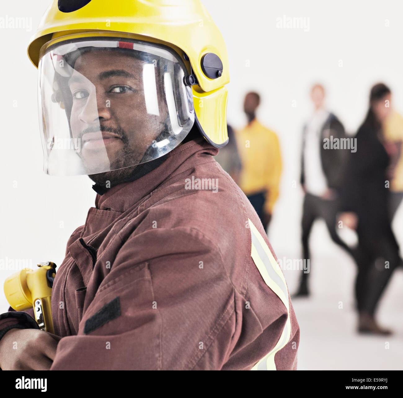 Portrait of confident fireman - Stock Image