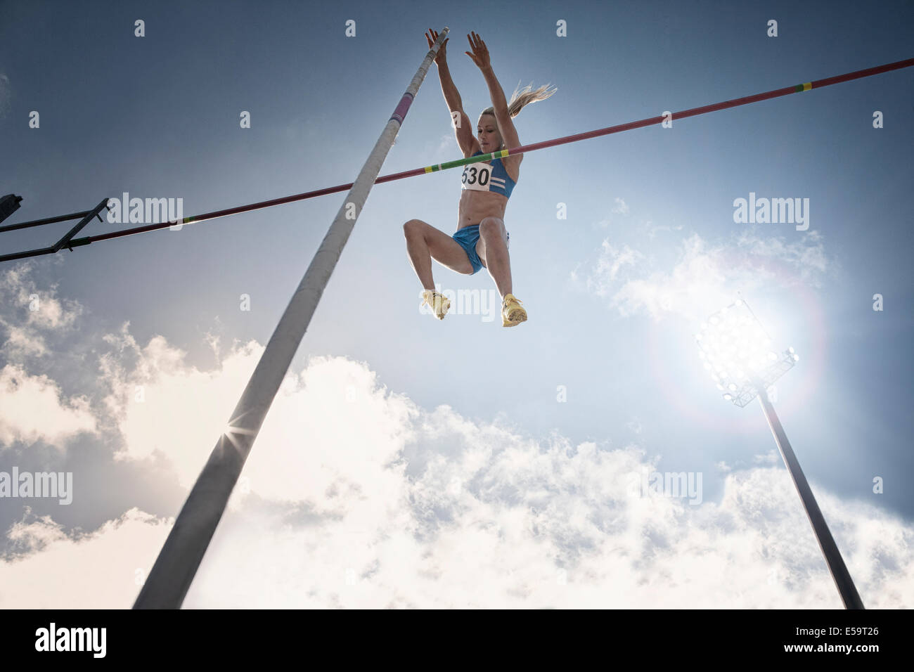 Pole vaulter clearing bar - Stock Image