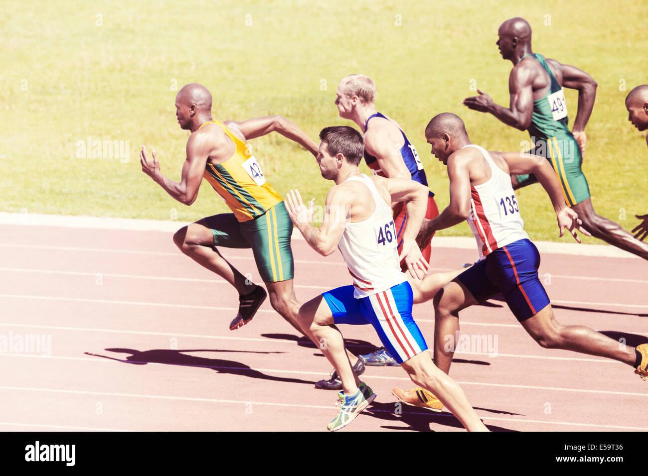 Sprinters racing on track - Stock Image