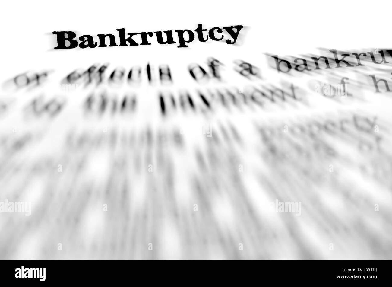 Zooming closeup of definition of the word bankruptcy - Stock Image
