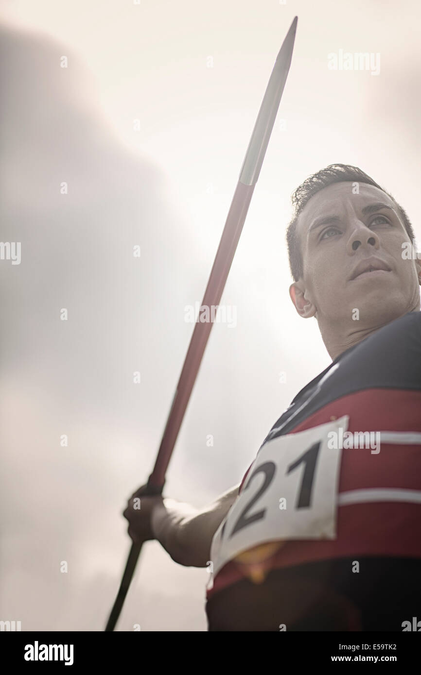 Track and field athlete holding javelin - Stock Image