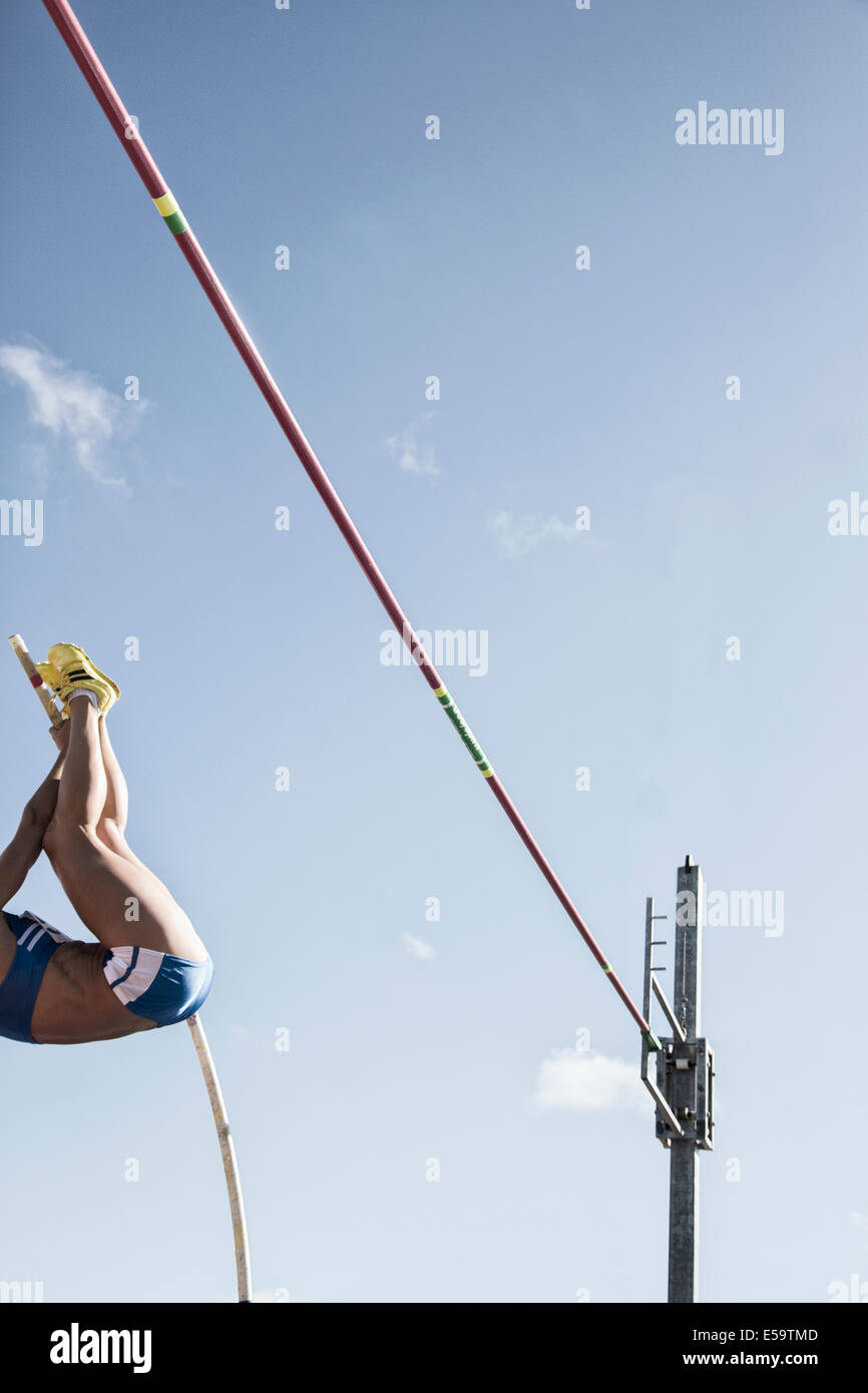 Pole vaulter nearing bar - Stock Image
