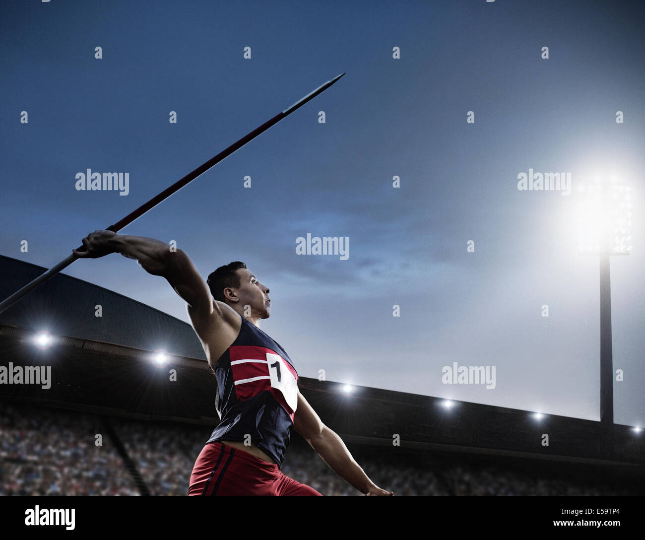 Track and field athlete throwing javelin - Stock Image
