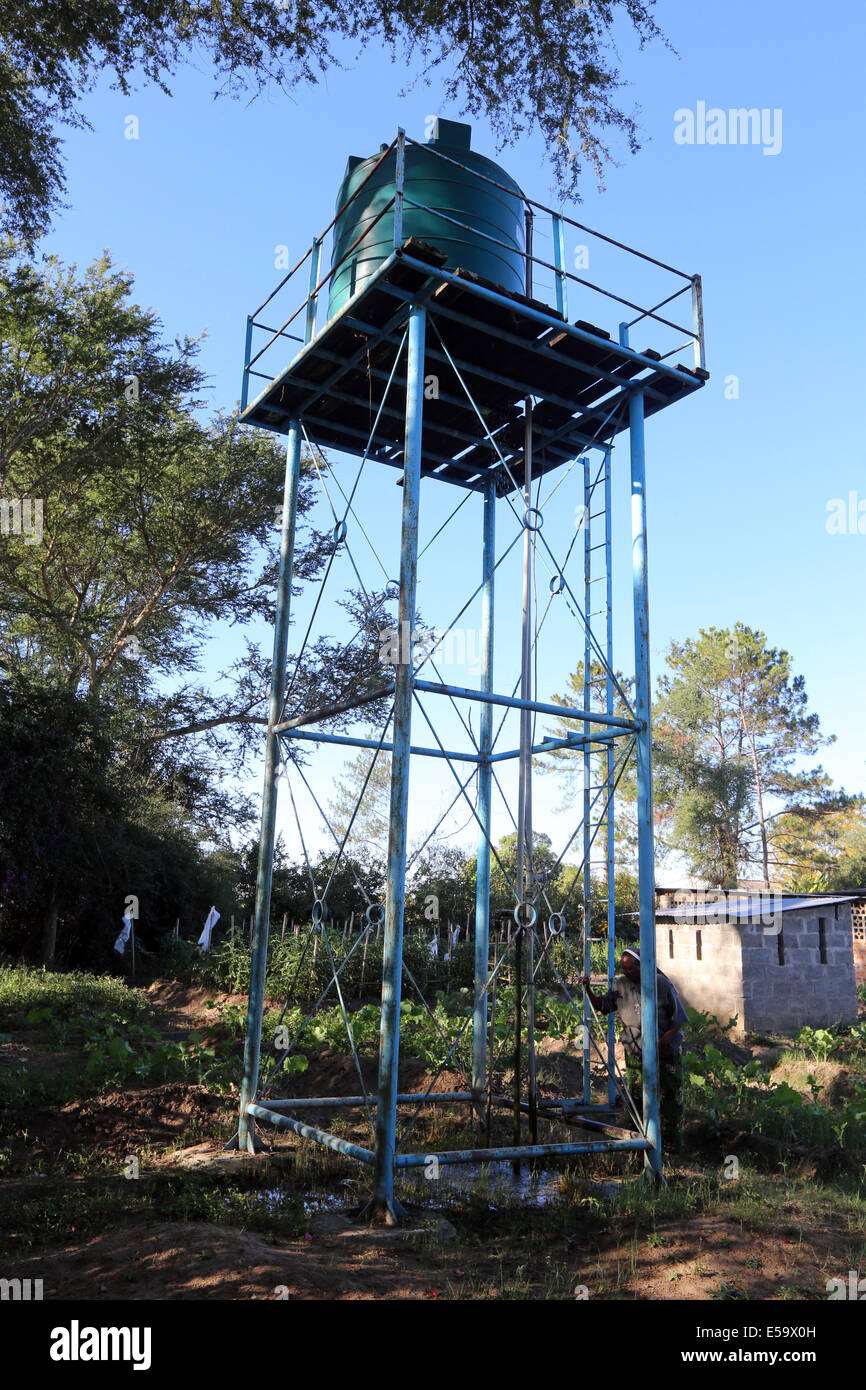 Water tank on a stand in a garden of a farm in Zambia