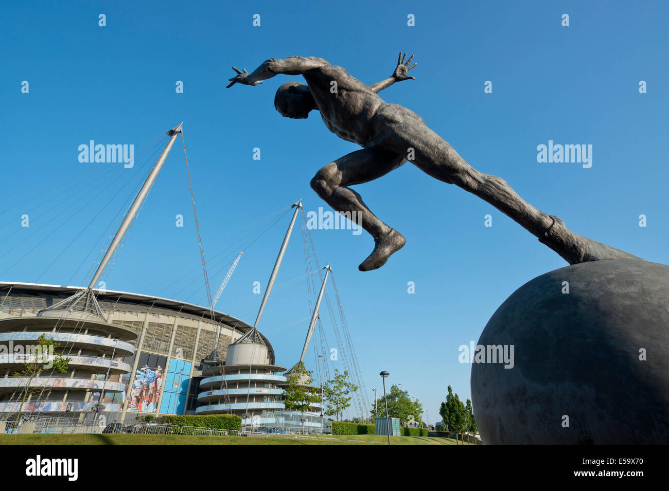 A statue of a sprinter the moment after the starting pistol near to the City of Manchester Etihad Stadium (Editorial - Stock Image