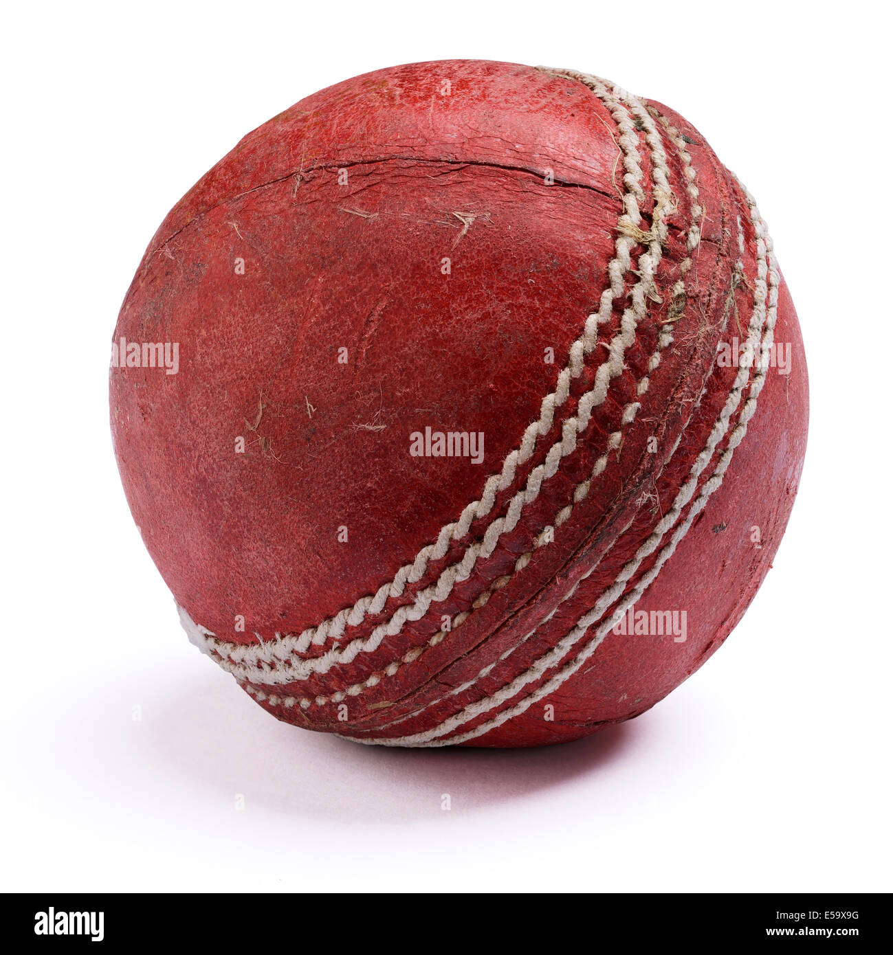 Old worn out red leather cricket ball Stock Photo