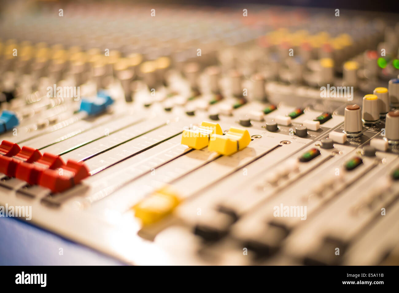 Slider on a sound mixer with blurs - Stock Image