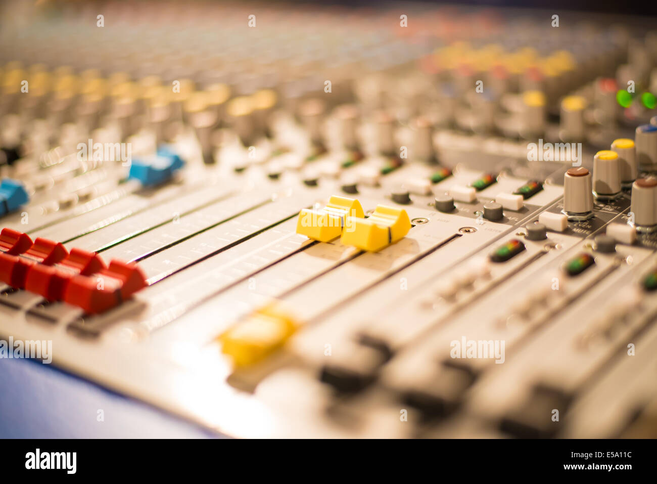 Slider on a sound mixer with blurs Stock Photo