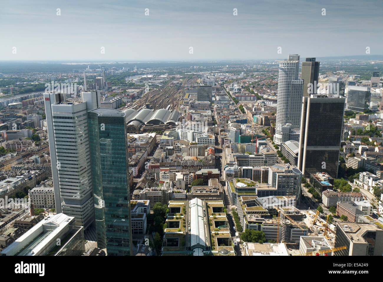Shot looking across over Frankfurt from the Main Tower with Frankfurt airport on the horizon. - Stock Image