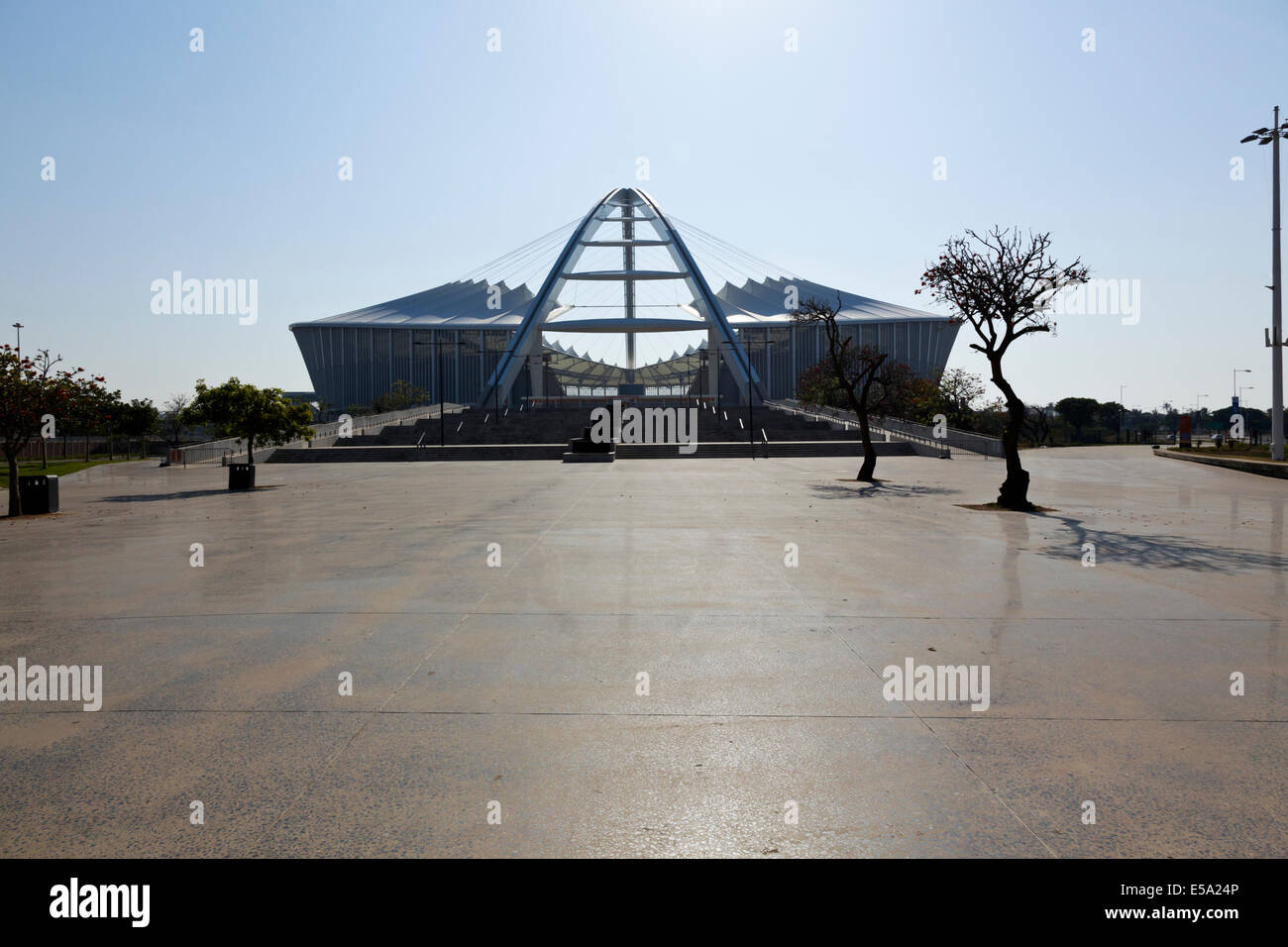 Durban, South Africa. Moses Madhiba 2010 world cup soccer Stadium back lit by the early morning sun. - Stock Image