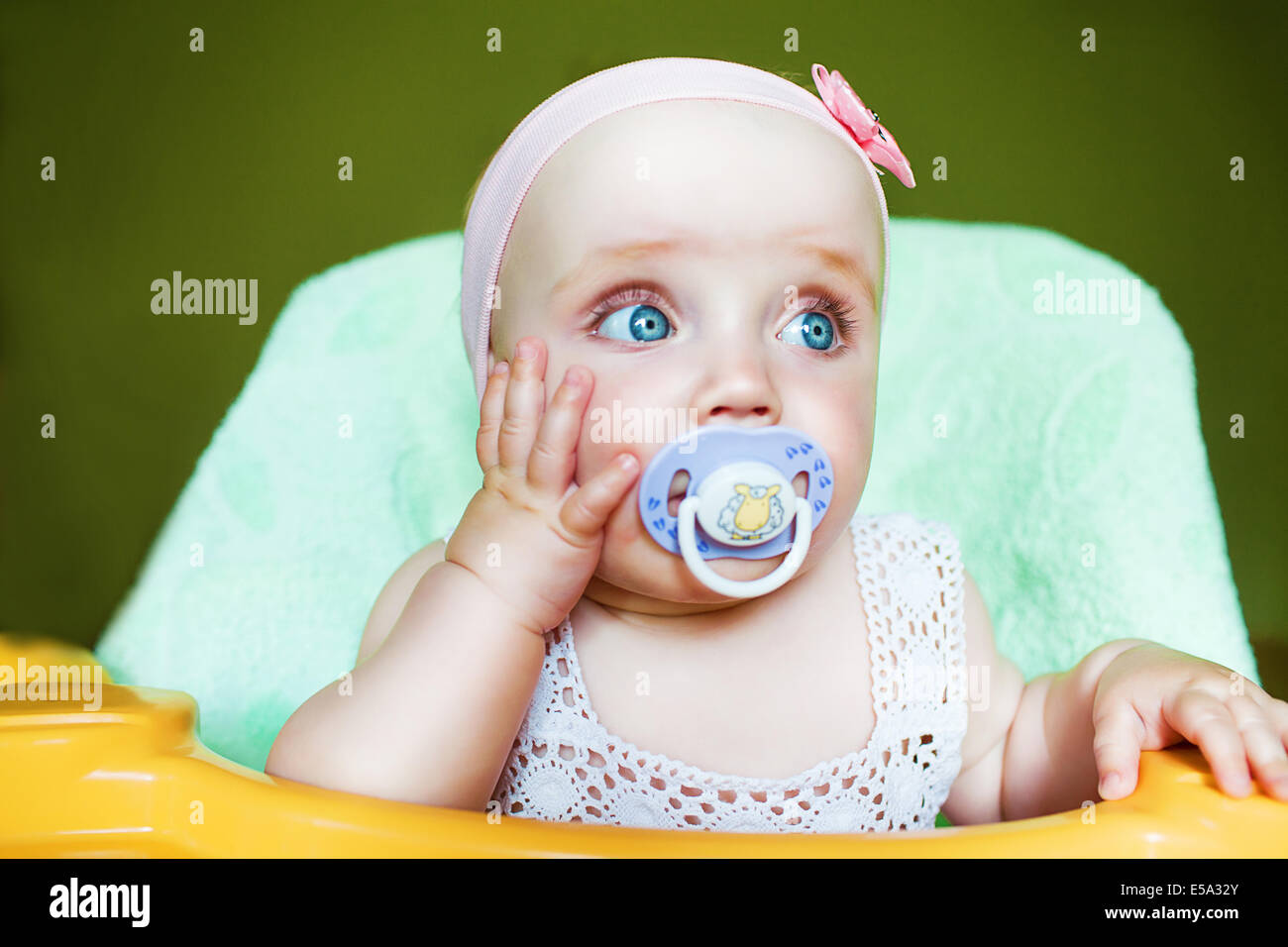 little cute child with baby's dummy in mouth - Stock Image
