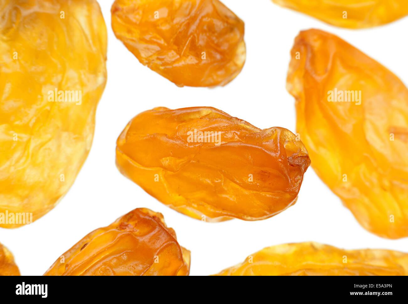 Yellow raisin closeup isolated on white Stock Photo