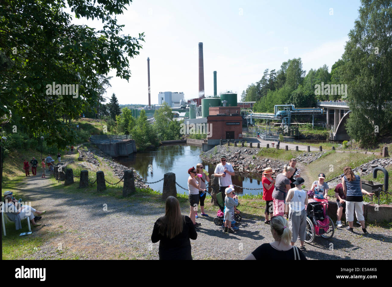 People standing in front of the sluice gates on the River Papila in Kyröskoski Finland - Stock Image