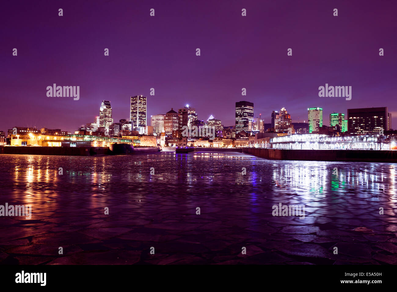 Montreal city skyline lit up at night, Quebec, Canada - Stock Image