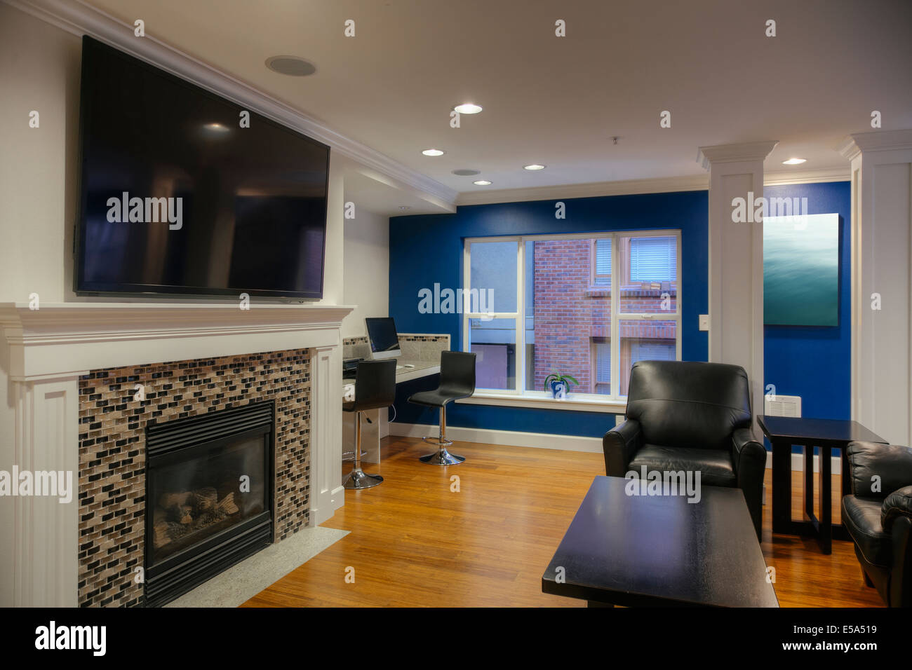 Fireplace and television in common area - Stock Image