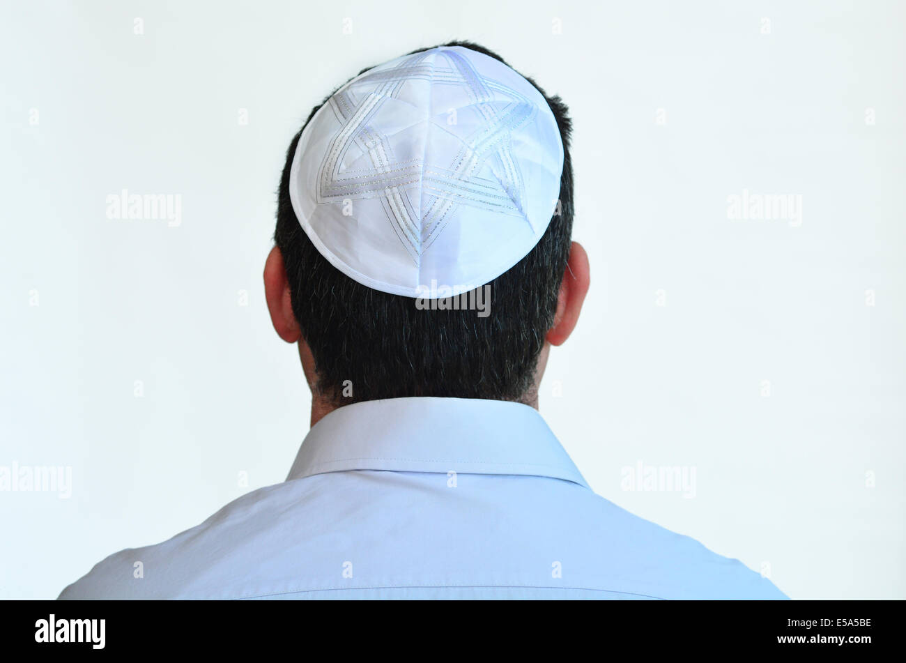 Jewish man with kippah isolated on white background. Concept photo Judaism ,religion belief, faith, lifestyle Stock Photo