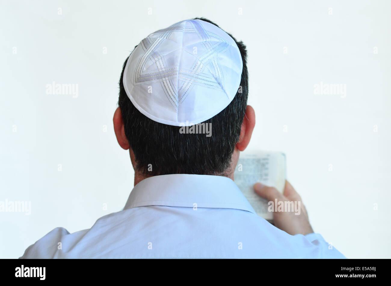 Jewish man with kippah pray isolated on white background. Concept photo Judaism ,religion belief, faith, lifestyle - Stock Image